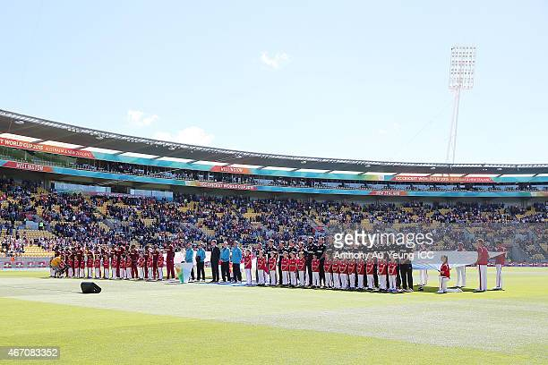 Players of New Zealand and West Indies line up for the national anthems during the 2015 ICC Cricket World Cup match between New Zealand and the West...