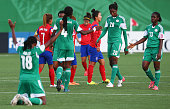 Players of Nigeria celebrate after the FIFA U20 Women's World Cup Canada 2014 group C match between Korea Republic and Nigeria at Moncton Stadium on...
