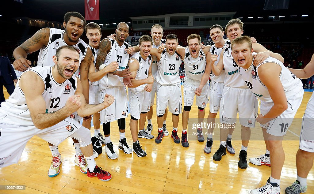 Players of Nizhny Novgorod celebrates victory during the 20142015 Turkish Airlines Euroleague Basketball Regular Season Date 9 game between Anadolu...