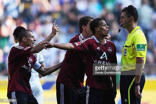 Players of Nuernberg argue with referee Knut Kircher during the Bundesliga match between Borussia Moenchengladbach and 1 FC Nuernberg at Borussia...