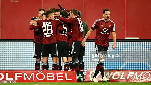 Players of Nuernberg celebrate their teams second goal scored by Guido Burgstaller of Nuernberg during the Second Bundesliga match between 1 FC...