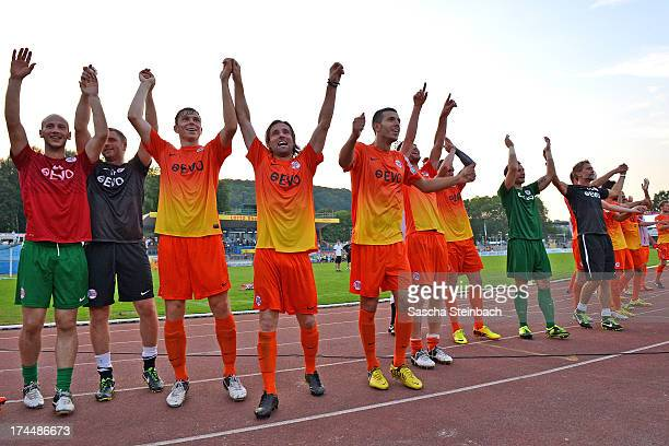 Players of Offenbach celebrate winning the Regionalliga Suedwest match between TuS Koblenz and Kickers Offenbach at Conlog Arena on July 26 2013 in...