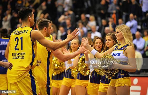 Players of Oldenburg celebrate with cheer leaders during the Bundesliga basketball match between EWE Baskets Oldenburg and Phoenix Hagen at Large EWE...