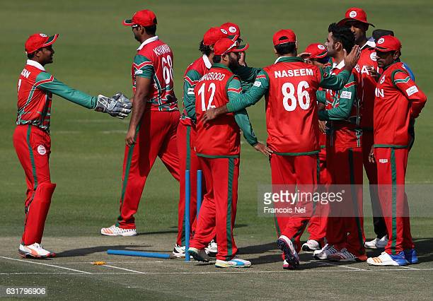 PLayers of Oman celebrate the wicket of Nizakat Khan during the Desert T20 Challenge match between at Hong Kong and Oman at Sheikh Zayed Stadium on...