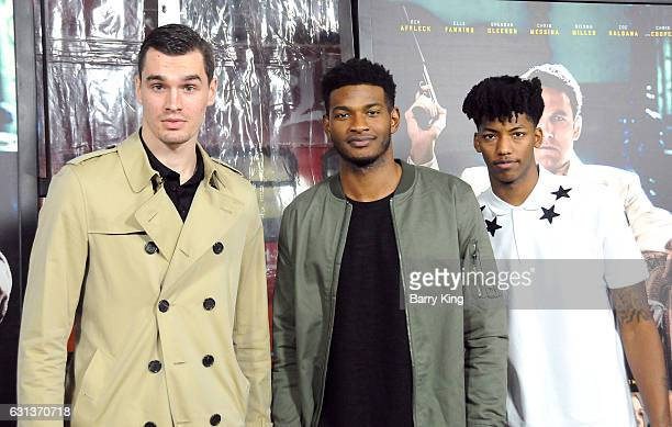 NBA Players of Orlando Magic Mario Hezonja CJ Wilcox and Elfrid Payton attend the premiere of Warner Bros Pictures' 'Live By Night' at TCL Chinese...