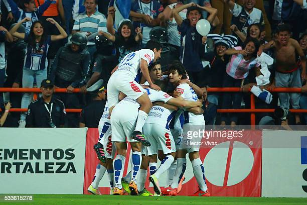 Players of Pachuca celebrate an own goal scored by Diego Novaretti of Leon during the semi finals first leg match between Pachuca and Leon as part of...