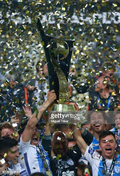 Players of Pachuca lift the trophy to celebrate after winning the Final second leg match between Pachuca and Tigres UANL as part of the CONCACAF...
