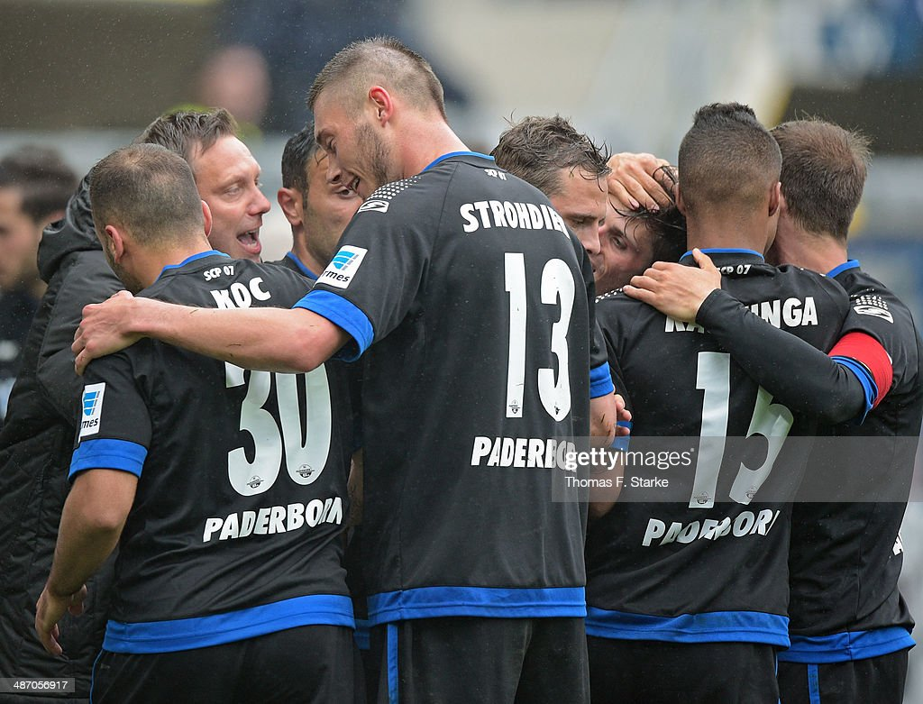 Players of Paderborn celebrate their first teams goal with head coach Andre Breitenreiter (2nd L) during the Second Bundesliga match between SC Paderborn and SV Sandhausen at Benteler Arena on April 27, 2014 in Paderborn, Germany.