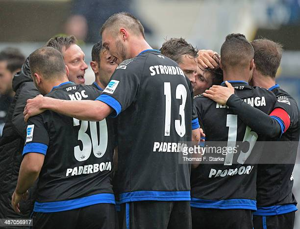 Players of Paderborn celebrate their first teams goal with head coach Andre Breitenreiter during the Second Bundesliga match between SC Paderborn and...