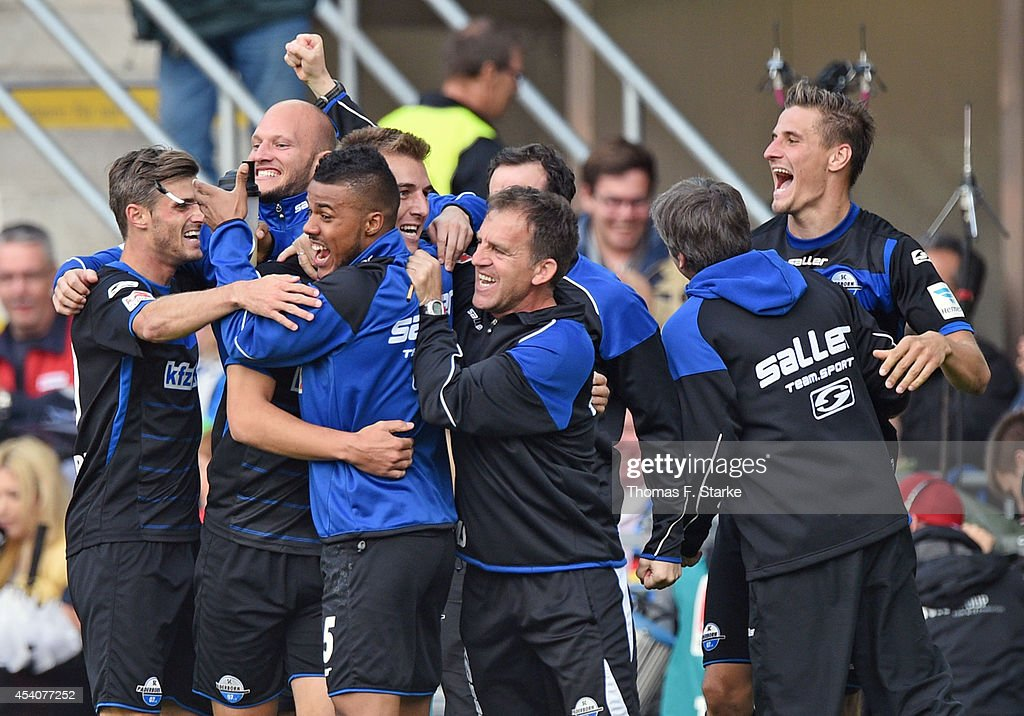 Players of Paderborn celebrate their second goal during the Bundesliga match between SC Paderborn and FSV Mainz 05 at Benteler Arena on August 24...