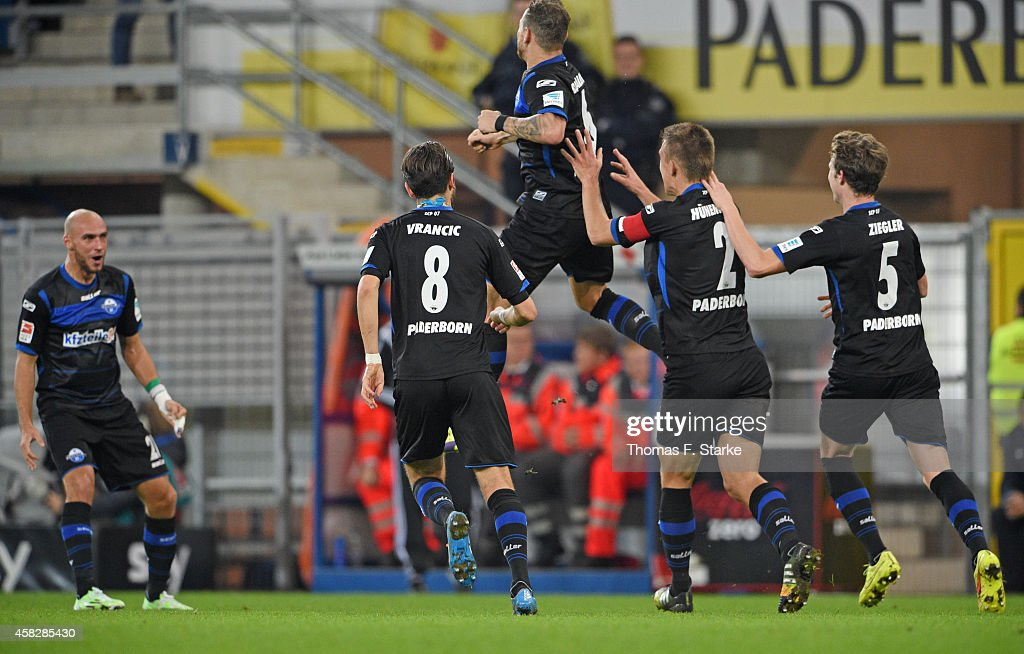 Players of Paderborn celebrate their teams first goal during the Bundesliga match between SC Paderborn and Hertha BSC at Benteler Arena on November 2...
