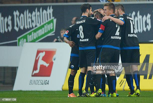 Players of Paderborn celebrate their teams first goal during the Second Bundesliga match between SC Paderborn and Dynamo Dresden at Benteler Arena on...