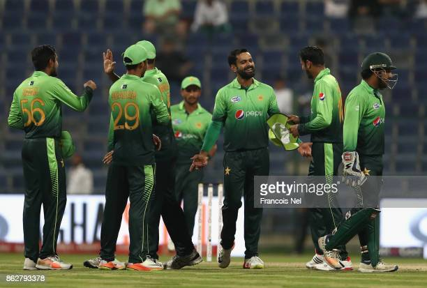 Players of Pakistan celebrate after dismissing Lahiru Thirimanne of Sri Lanka during the third One Day International match between Pakistan and Sri...