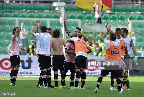 Players of Palermo celebrate after winning the Serie A match between US Citta di Palermo and FC Internazionale Milano at Stadio Renzo Barbera on...