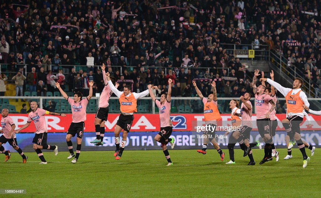 Players of Palermo celebrate after winning the the Serie A match between US Citta di Palermo and Calcio Catania at Stadio Renzo Barbera on November 24, 2012 in Palermo, Italy.