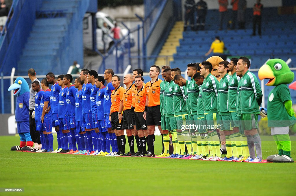 Players of Palmeiras and Sao Caetano line up prior to a match between Sao Caetano and Palmeiras as part of Paulista Championship 2013 at Anacleto Campanella Stadium on March 17, 2013 in Sao Caetano, Brazil.