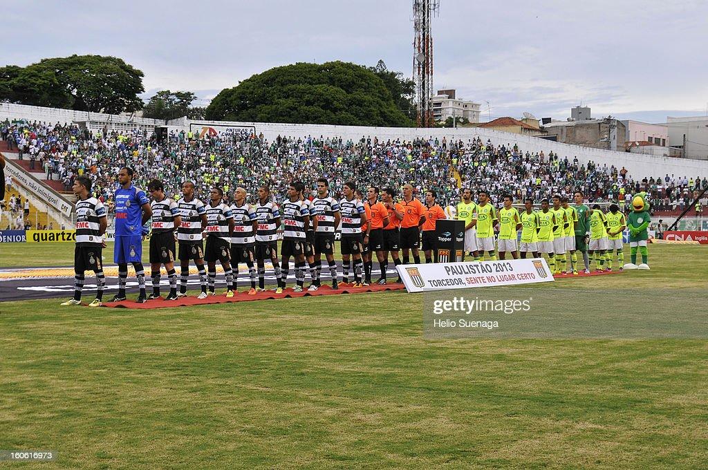 Players of Palmeiras and XV de Piracicaba stand before the match between Palmeiras and XV de Piracicaba as part of Campeonato Paulista 2013 at Barão de Serra Negra Stadium on February 3, 2013 in Piracicaba, Brazil.