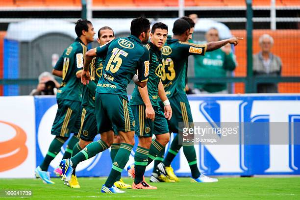 Players of Palmeiras celebrate a goal against Guarani during a match between Palmeiras and Guarani as part of Paulista Championship 2013 at Pacaembu...