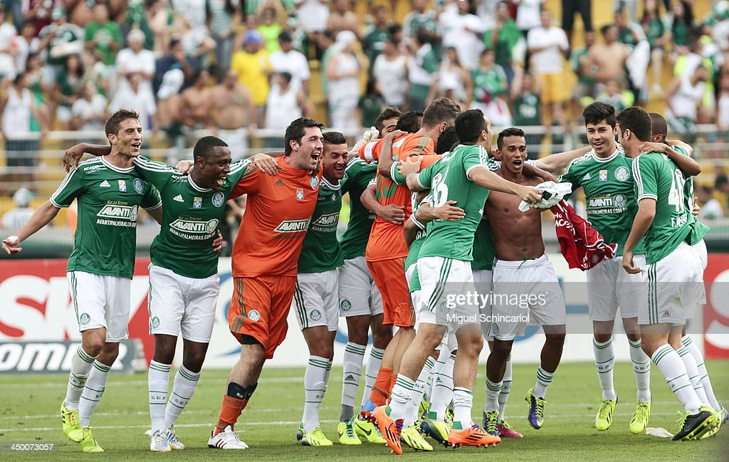 Players of Palmeiras celebrate after the match between Palmeiras and Boa Esporte for the Brazilian Championship Series B 2013 at Pacaembu Stadium on November 16, 2013 in Sao Paulo, Brazil.