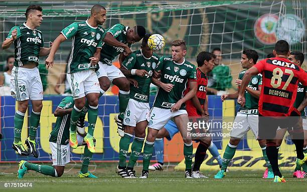 Players of Palmeiras jumps up in the wall during a free kick from Diego Souza of Sport Recife during the match between Palmeiras and Sport Recife for...