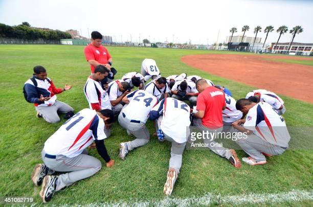 Players of Panama pray before a match between Bolivia and Panama as part of the XVII Bolivarian Games Trujillo 2013 at Villa Regional del Callao on...
