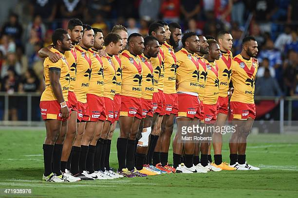 Players of Papua New Guinea stand during the national anthem before the International Test Match between TOA Samoa and Tonga at Cbus Super Stadium on...