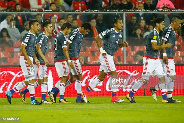 Players of Paraguay celebrate after Arturo Vidal of Chile scored an own goal during a match between Chile and Paraguay as a part of FIFA 2018 World...