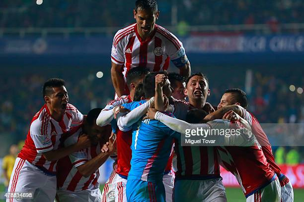 Players of Paraguay celebrate after the 2015 Copa America Chile quarter final match between Brazil and Paraguay at Ester Roa Rebolledo Stadium on...