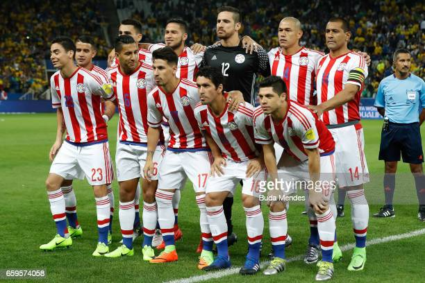 Players of Paraguay pose for photographers before a match between Brazil and Paraguay as part of 2018 FIFA World Cup Russia Qualifier at Arena...