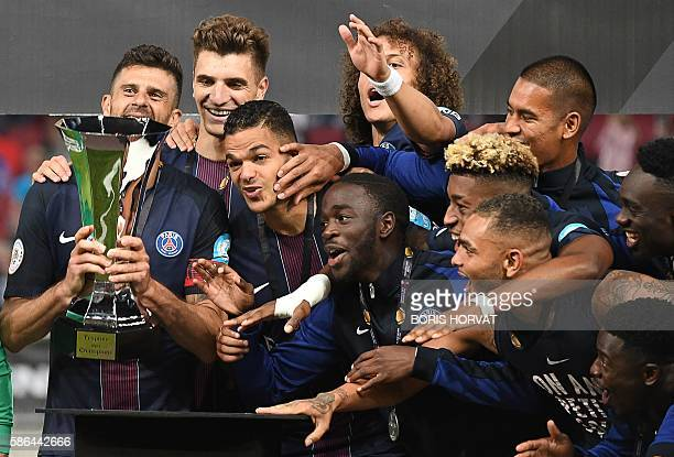 Players of Paris SaintGermain celebrate with the trophy after winning the French Supercup Champions trophy football match Paris SaintGermain vs...
