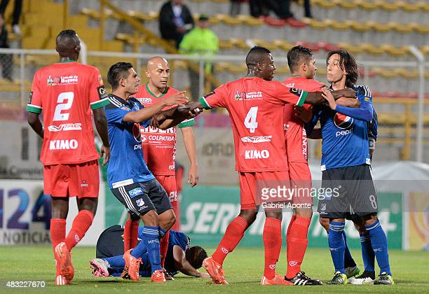 Players of Patriotas and Millonarios scuffle during a match between Patriotas FC and Millonarios as part of Liga Aguila II 2015 at Metropolitano de...