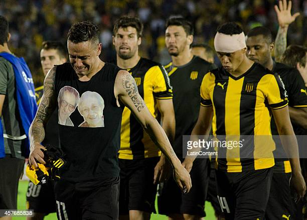 Players of Peñarol look dejected after losing in a penalty shootout during a second leg match between Peñarol and Estudiantes as part of round of 16...