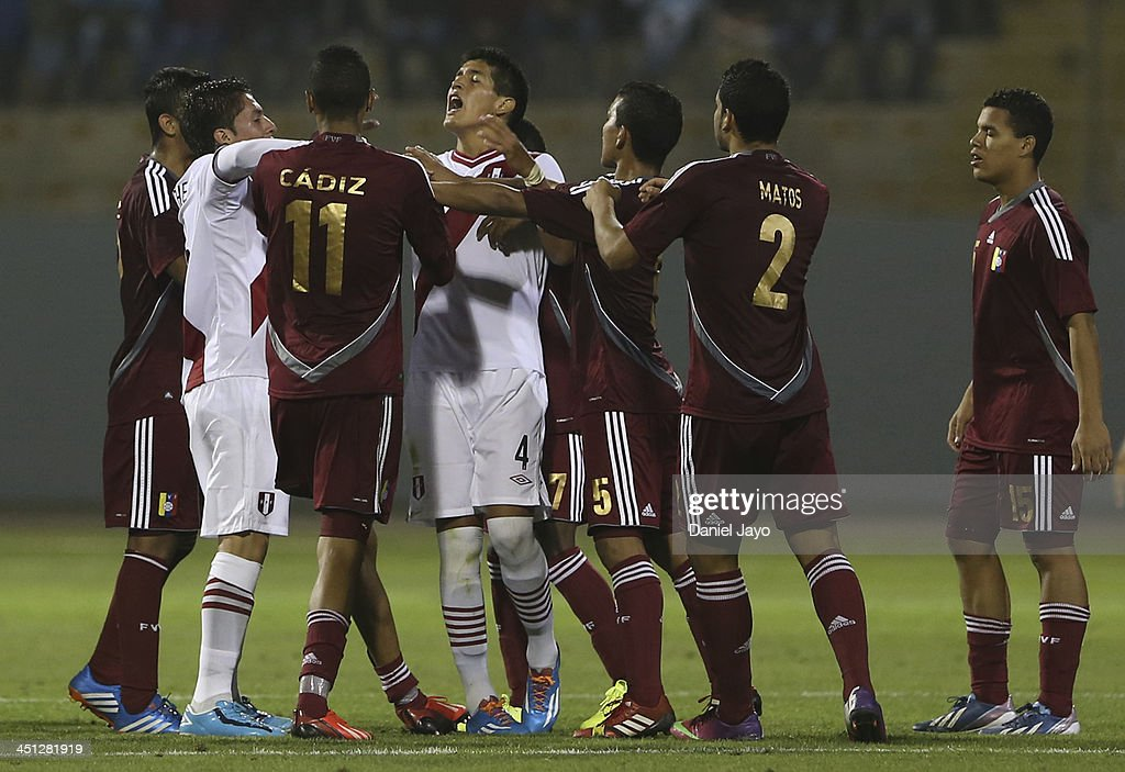 Players of Peru and Venezuela scuffle during a soccer U18 event as part of the XVII Bolivarian Games Trujillo 2013 at Mansiche Stadium on November 21, 2013 in Lima, Peru.
