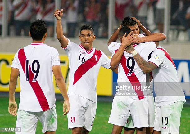 Players of Peru celebrate a goal against Chile during a match between Peru and Chile as part of the 11th round of the South American Qualifiers for...