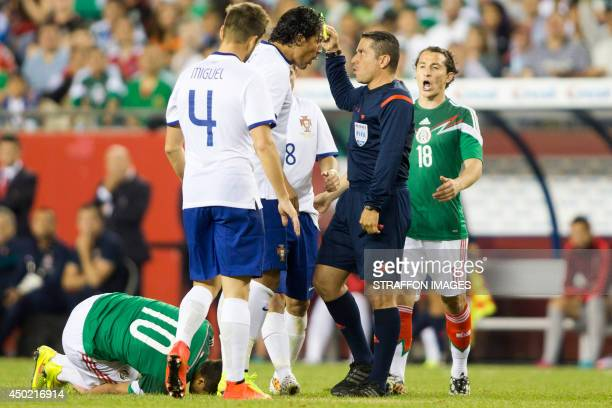 Players of Portugal argue with the referee during the International friendly match between Mexico and Portugal at Gillette Stadium on June 06 2014 in...