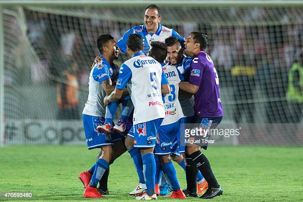 Players of Puebla carry teammate Cuauhtemoc Blanco after winning the Championship match between Puebla and Chivas as part of Copa MX Clausura 2015 at...