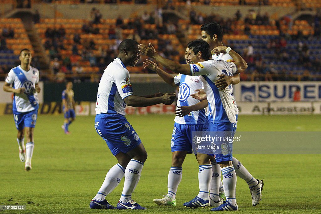 Players of Puebla celebrate a goal against San Luis during a match between San Luis and Puebla as part of the Clausura 2013 Liga MX at Alfonso Lastras Stadium on February 09, 2013 in San Luis Potosi, Mexico.