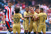 Players of Pumas celebrates after Jair Pererira of Chivas scored an own goal during the 1st round match between Pumas UNAM and Chivas as part of the...