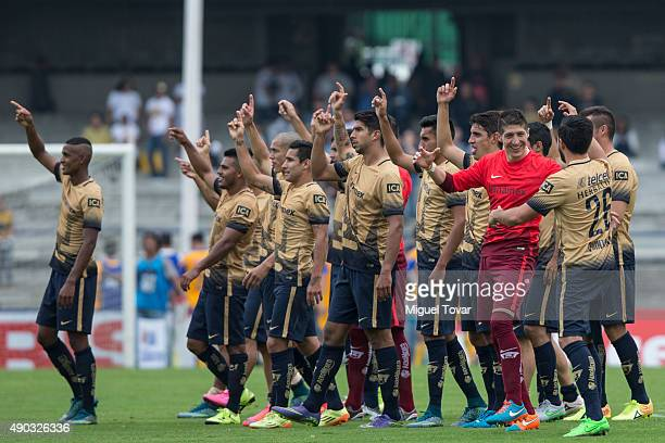 Players of Pumas cheer their fans after defeating Tigres during a 10th round match between Pumas UNAM and Tigres UANL as part of the Apertura 2015...