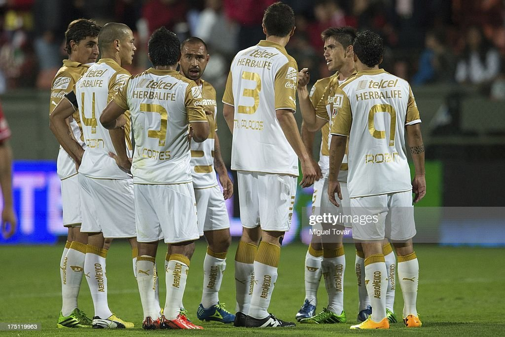 Players of Pumas discuss during a match between Toluca and Pumas as part of the Torneo Apertura 2013 Liga MX at Nemesio Siez stadium, on July 31, 2013 in Toluca, Mexico.