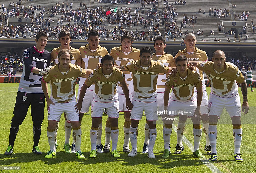 Players of Pumas pose for team photo prior to a match between Pumas and Santos as part of the Apertura 2013 Liga MX at Olympic Stadium on October 06, 2013 in Mexico City, Mexico.