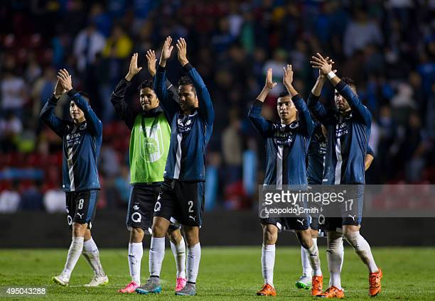 Players of Querétaro celebrate the victory after the 15th round match between Queretaro and Monterrey as part of the Apertura 2015 Liga MX at La...