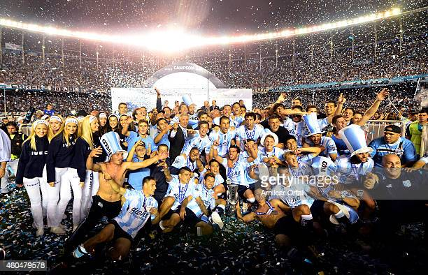 Players of Racing Club celebrate the championship after winning a match between Racing Club and Godoy Cruz as part of 19th round of Torneo de...