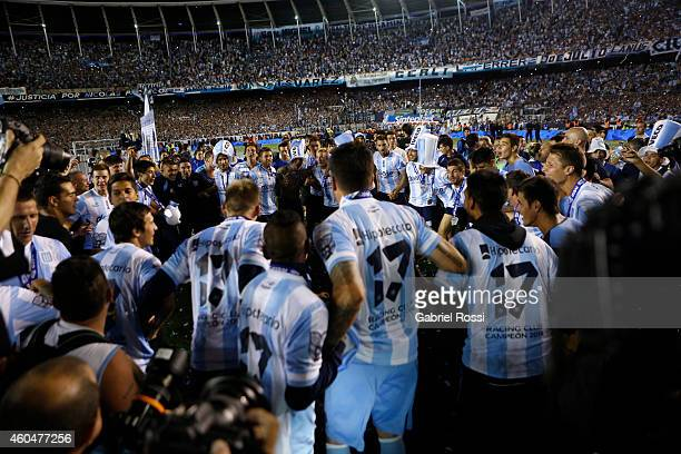Players of Racing Club celebrate the championship around the trophy after winning a match between Racing Club and Godoy Cruz as part of 19th round of...
