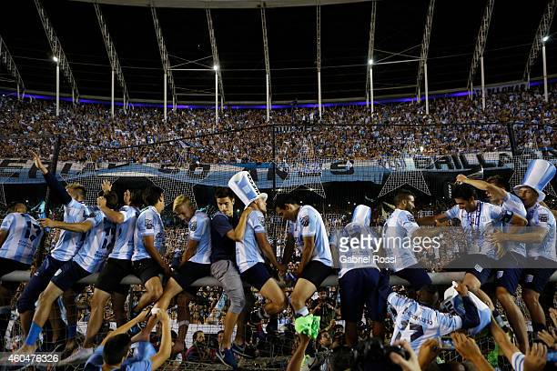 Players of Racing Club celebrate the championship with fans after winning a match between Racing Club and Godoy Cruz as part of 19th round of Torneo...