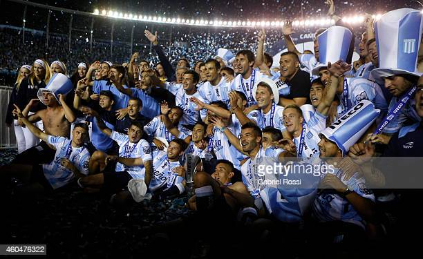 Players of Racing Club pose for a photo celebrating the championship after winning a match between Racing Club and Godoy Cruz as part of 19th round...