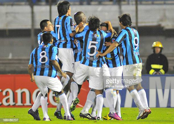 Players of Real Garcilaso celebrate after winning the match between Nacional de Montevideo from Uruguay and Real Garcilaso from Peru as part of the...