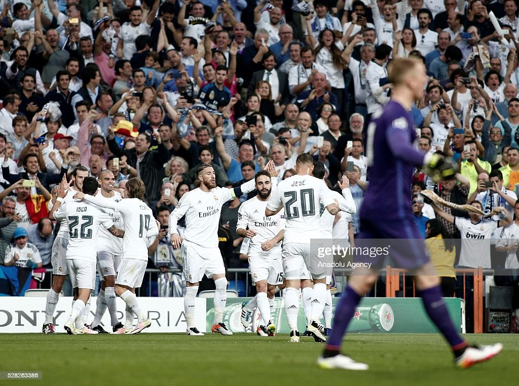 Players of Real Madrid celebrate a goal scored by Gareth Bale during the UEFA Champions League semi-final second leg football match between Real Madrid and Manchester City at the Santiago Bernabeu Stadium in Madrid, Spain on May 4, 2016.