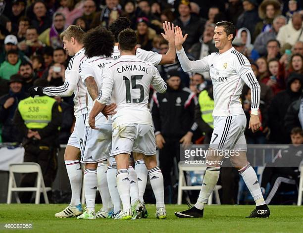 Players of Real Madrid celebrate after Cristiano Ronaldo's goal during the Spanish La Liga soccer match between Real Madrid and RC Celta at the...