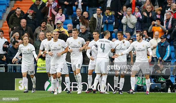 Players of Real Madrid celebrate after scoring during the La Liga match between Real Madrid CF and Rayo Vallecano at Estadio Santiago Bernabeu on...